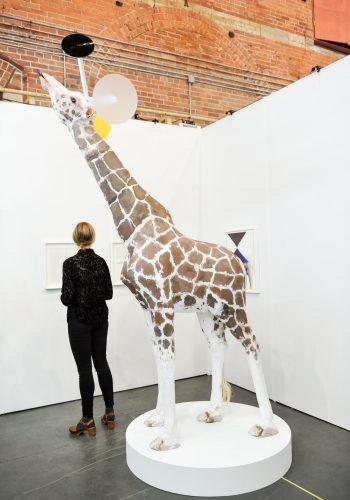 "Trevor Gould A Trick of the Eye, 2014 Contreplaqué, styromousse, plâtre, argile, époxy, plexiglass Plywood, styrofoam, plaster, pigment, clay , epoxy, plexiglas Giraffe-mobile: 102""(h) x 24""(w) x 72""(l) Base: 7"" (h) x 48"" (diam.)"