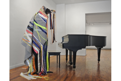 Maria Hupfield, Silent Noise for a Piano, 2015 Industrial felt cover with satin ribbon on wood structure (piano not included) Dimensions vary with installation (Installation, How to catch eel and grow corn, AMERINDIA, Wilmer Jennings Gallery, New York, USA.)