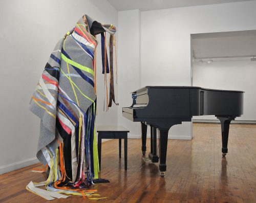 Maria Hupfield Silent Noise for a Piano, 2015 Feutre industriel couvert de rubans de satin sur structure en bois (piano non compris) Industrial felt cover with satin ribbon on wood structure (piano not included) Les dimensions varient dépendant de l'installation Dimensions vary with installation (Installation, How to catch eel and grow corn, AMERINDIA, Wilmer Jennings Gallery, New York, USA.)
